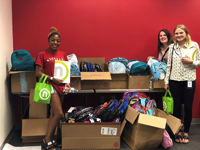 New Nelnet Associates Giving Backpacks to those in need