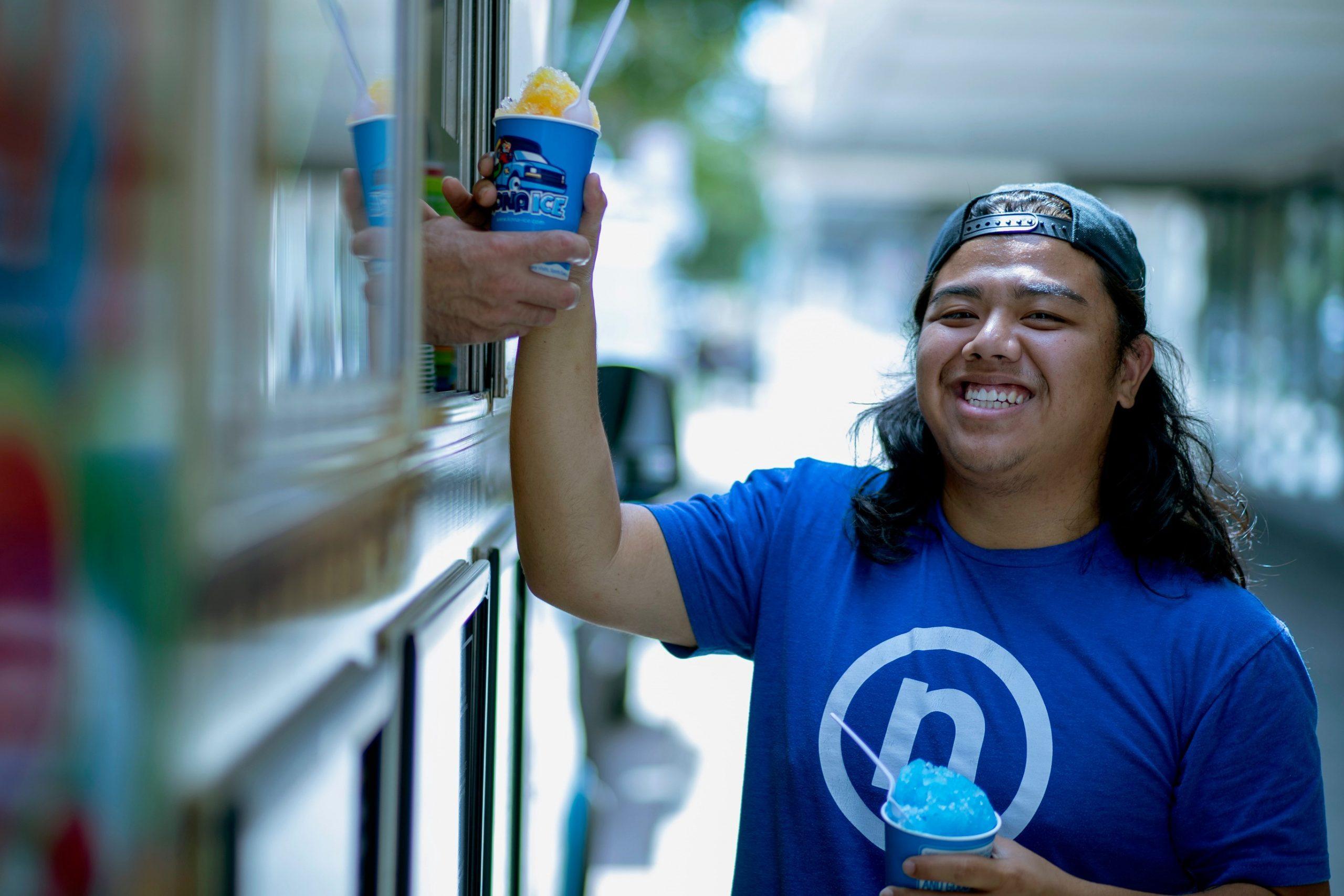 Nelnet associate at food truck receiving Kona shaved ice